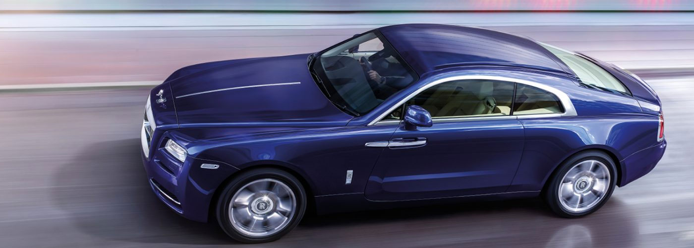 Rolls-Royce Wraith Purple Driving on street
